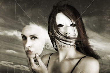 stock-photo-319366-young-woman-wearing-mask-and-holding-face